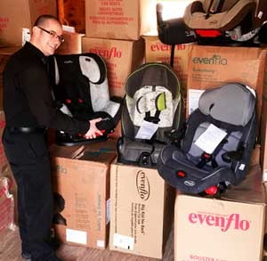 Officer with infant car seats